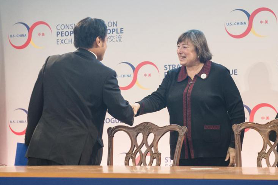 Under Secretary of State Catherine Novelli shakes hands with Frederick Yeh at the U.S. Department of State.