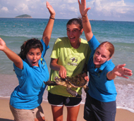 Interns cheering with sea turtle