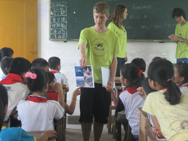 Educating local students about sea turtle conservation and English