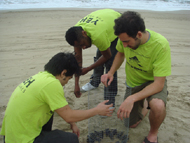 Chinese teacher and Volunteers protect sea turtle hatchlings