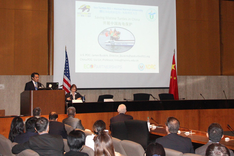 U.S. Ambassador Judith Garber listens to Frederick Yeh speak about saving sea turtles.