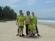 Staff and Volunteers with sea turtle on Sanya Beach
