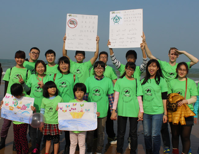 Student group at beach raising awareness for sea turtle conservation